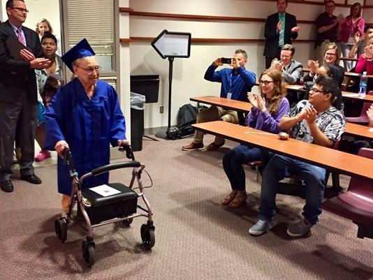 © 88-year-old Ester Begam enters an auditorium at Wayzata High School for her graduation