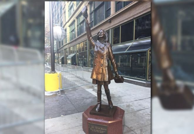 A statue of Mary Tyler Moore tossing her hat in the air is back at its familiar spot in downtown Minneapolis.