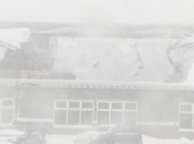 © A photographer at NBC 26 in Green Bay captured this photo of the Econo Lodge roof collapse while snow fell.