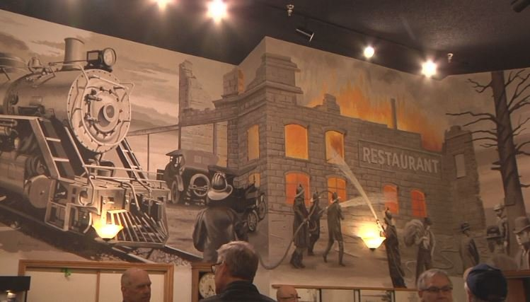 Local artist unveils 1918 fire mural in Moose Lake Museum