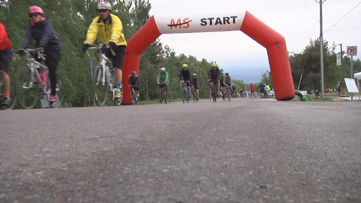Dozens of people gather in Proctor to bike for a good cause