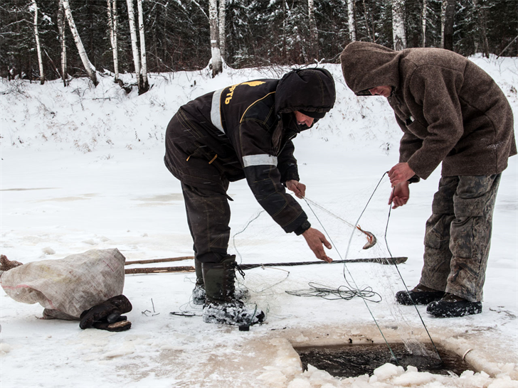 Minnesota ice anglers with wheeled fish houses need for Fishing license minnesota